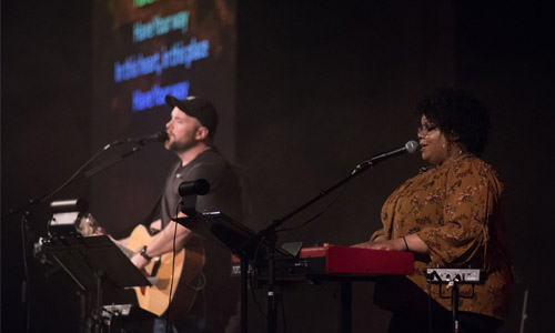 Two people leading worship