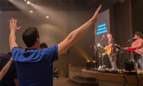 Man worshipping with hands raised